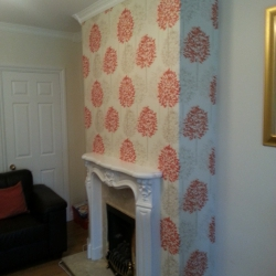 Feature wallpaper over fireplace